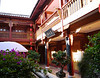 The Lijiang Yingxianggucheng Wenyuan Hotel courtyard, complete with tiny canal, to reflect its location in the canal town of Lijiang in Yunnan Province.