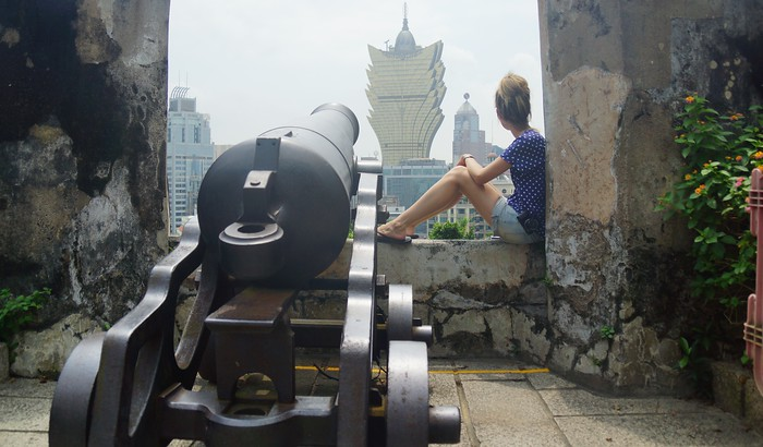 A canon and The Grand Lisboa in Macao