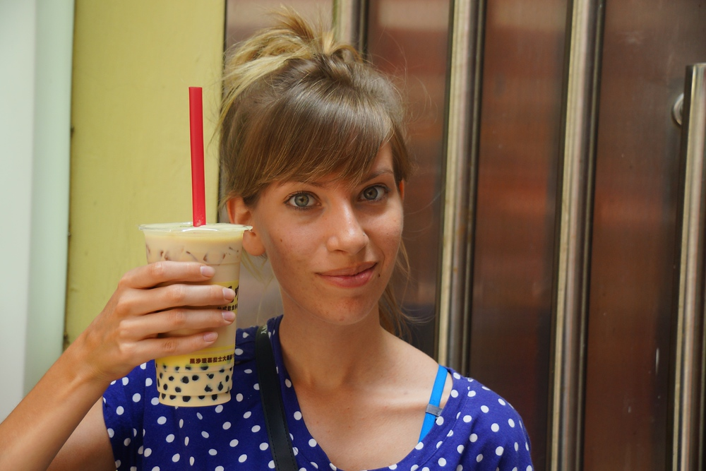 Audrey holding a refreshing cup of Pearl Milk Tea in her hand in Macau, China