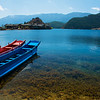 Lugu Lake_boats_Lige Peninsula