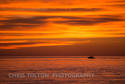 Boat Underway on an Orange Morning