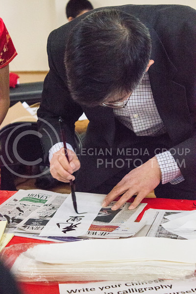 Chinese calligraphy demonstrations were available at the Chinese culture fair at Fiedler Hall on Jan. 28th, 2017. ( Kelly Pham | The Collegian)