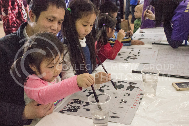 Children learning how to write Chinese letter at the Chinese culture fair at Fiedler Hall on Jan. 28th, 2017. (Kelly Pham | The Collegian)