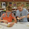 Preston Iser (left) and Flynn Magill make traditional Chinese dumplings on Friday during Startalk's Chinese language immersion program at DeKalb High School.