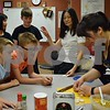 Agnes Ma (right) and her mother Linda Ma show students how to form traditional Chinese dumplings Friday during Startalk's Chinese language immersion program. The three-week camp for students who have completed third through eighth grades runs through June 30 at DeKalb High School.