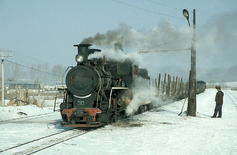 C2 30 takes on water amidst a snowy scene at Pinglin, on the Weihe Forestry Railway. Weihe is approximately 190 km east of Harbin, on the line to Mudanjiang. 7th February 2002