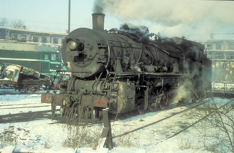 My first sighting of a JF class locomotive was JF 2413, which was the depot pilot for many years at Changchun locomotive depot, where it is seen here. Notice that she has an improvised coal bunker instead of the normal tender to facilitate movements within the resricted confines of the depot. 6th January 1994