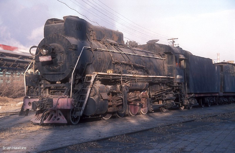 The first location which our group visited was Baotou steelworks, commencing with the main locomotive servicing point, where 2-8-2 JS 58001 is seen, having been dumped here since at least November 2003. 16th November 2008