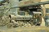 C2 No. 1 is seen derelict outside the locomotive depot at Dahuichang. 29th October 1999