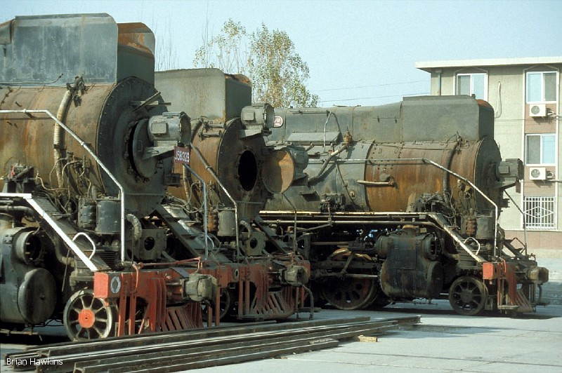 A line up of withdrawn JS 2-8-2s: JS 8329, JS 8004 and JS 8320 stand at Baotou Xi Locomotive Depot. 2nd November 2001