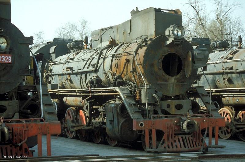 Withdrawn JS 8004 and other JS class 2-8-2s languish at Baotou Xi locomotive depot. 2nd November 2001