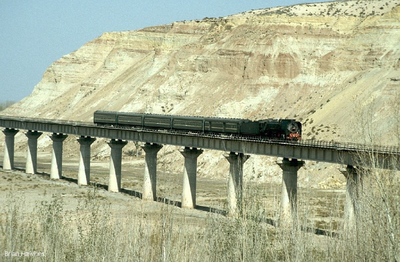QJ 6784 hauls a passenger train across the long viaduct in Singing Sands Gorge. 29th October 2001