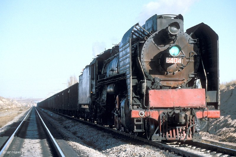 QJ 6404 is the banking engine on a loaded coal train at Aobaogou station. The train is headed by QJ 6194+ QJ 6178. 31st October 2001