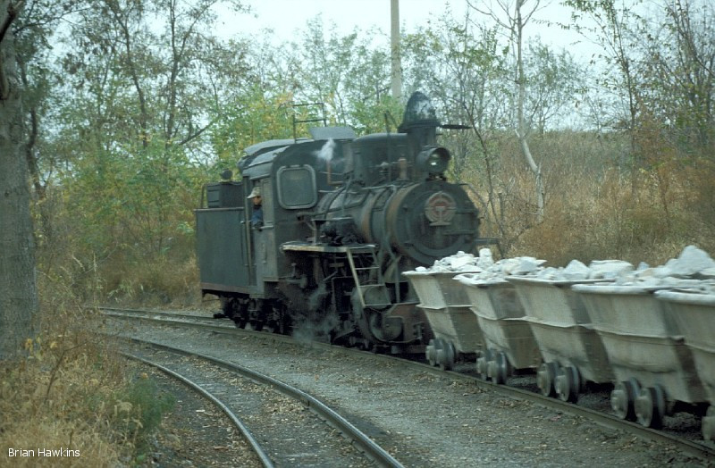 0-8-0 C2 2 works a train of full limestone tubs at Dahuichang. 3rd November 2001