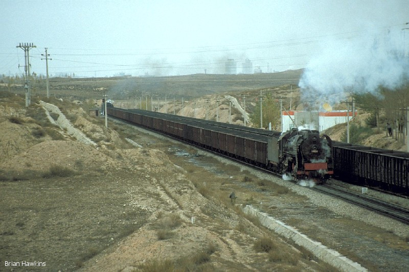 QJ 6404 is the banking engine as it passes through Aobaogou with a loaded coal train. 30th October 2001