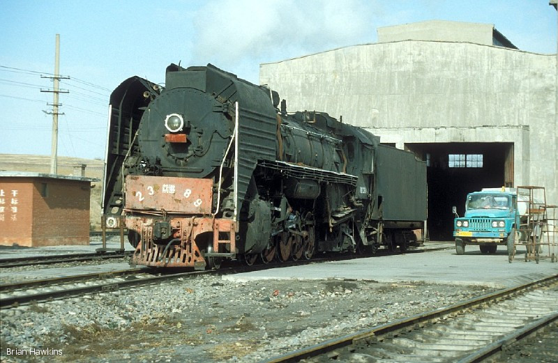 QJ 2389 stands in light steam ouside of the locomotive depot at Dongsheng. 1st November 2001
