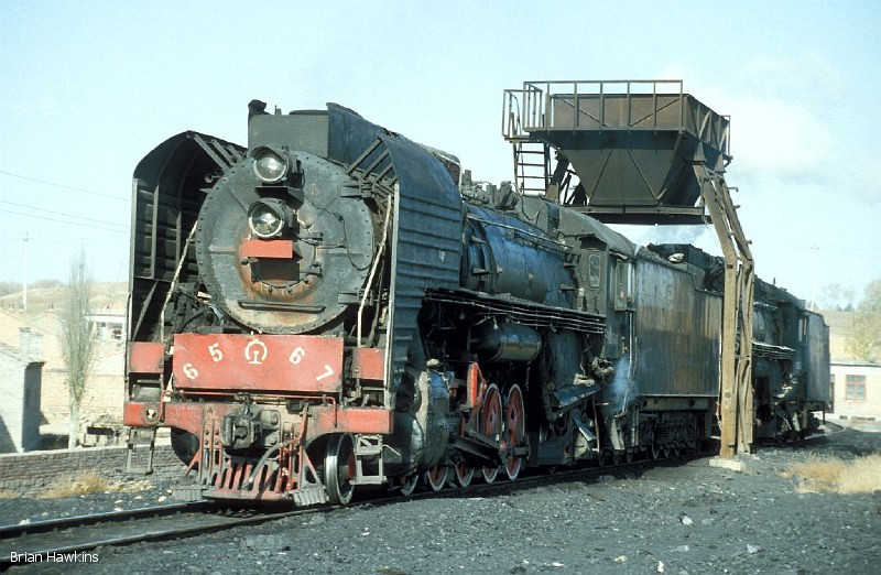 Another view of QJ 6567 + QJ 2389 at Dongsheng locomotive depot. 1st November 2001