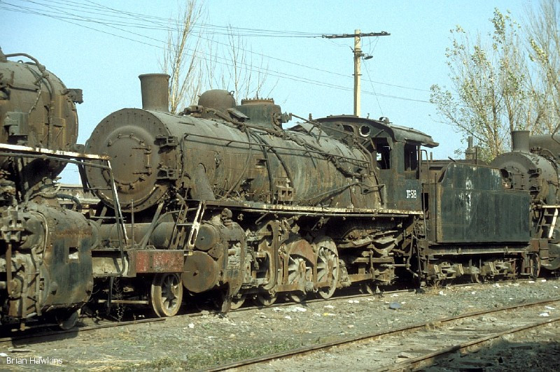 Once again at Baotou, preservation seems to be more of a long-term project than a reality. This time it's JF 518 which is gathering rust. 2nd November 2001.