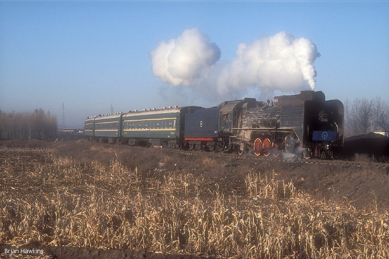 Another view of JS 8242 with the 07:00 Xishan (Yuanbaoshan) - Fengshuigou passenger service; this working is normally a mixed train, with empty coal wagons for the mine at Fengshuigou, but on this occasion no wagons were included. 2nd November 2009
