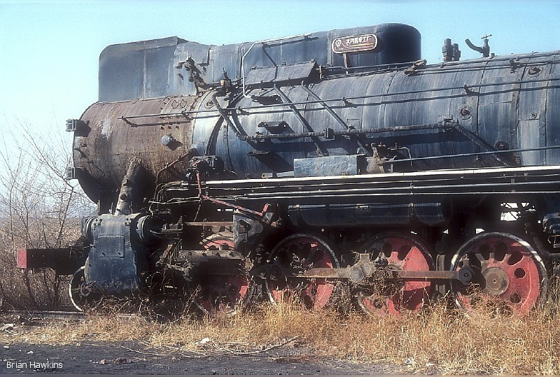 The front end of stored JS class 2-8-2 JS 8218 seen at Pingzhuang workshops; this ex Yuanbaoshan locomotive waits for a very uncertain future along with sister engines 6246, 6544, 8216 and 8246. 4th November 2009
