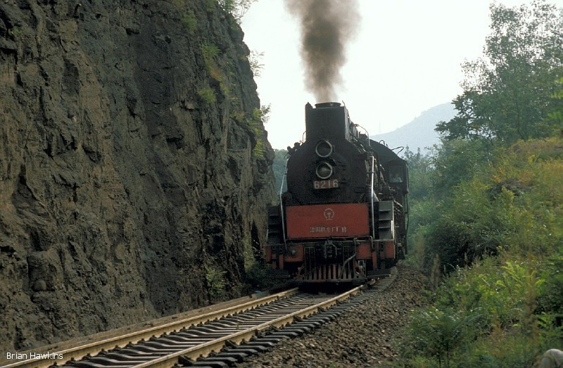 JS 6216 hauls another coal train up the steep climb to Chengde steelworks. 19th September 2000
