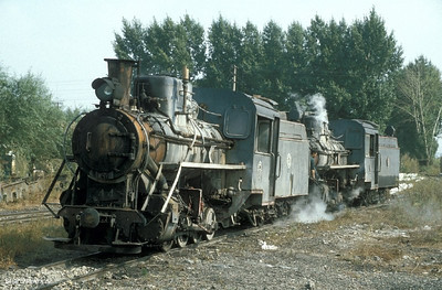 C2 168 drags out sister loco C2 044 from the locomotive depot at Huanan. 18th September2002