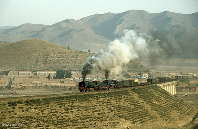 QJ 6517 + QJ 6828 are seen crossing Reshui river bridge in the early morning as they start the battle over the Jingpeng Pass. 26th September 2002