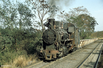 C2 No.2 heads towards the quarry at Dahaichang for it's train to be reloaded. 6th October 2002