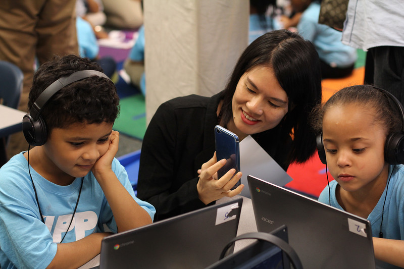 Lynn, Ma. 9-18-17. KIPP  kindergarten students Justice Victoriano, left, and Jahnelix Pinales, right, work away as Alyssa Lai, a school principal from China, takes note of them during her tour of KIPP today.