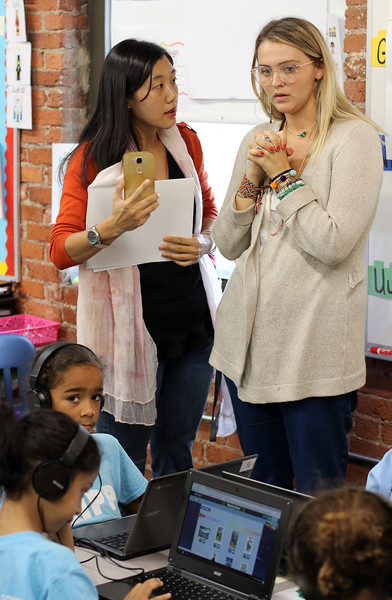 Lynn, Ma. 9-18-17. Chinese principal Sophia Han, left, talks with KIPP kingarten teacher Miss Kelsey Mullen,right, during the tour of KIPP.