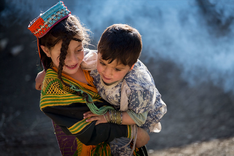 Young Kalasha girl with brother.
