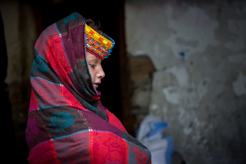 A Kalasha girl preparing to go to school.