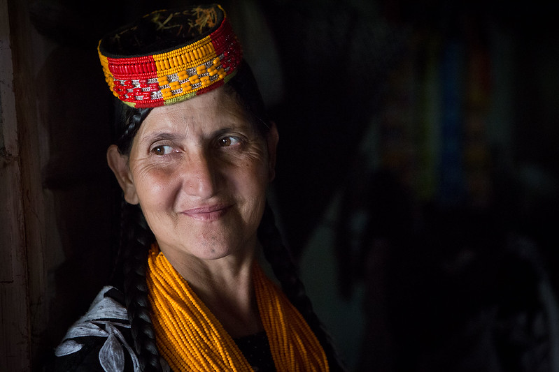 A Kalasha lady standing in the door to her home.