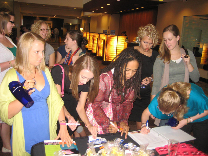 Women gather to sign in and show off some fabulous Women of the ELCA items--now that's an attractive Cafe travel mug!