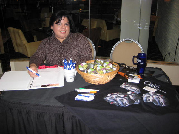 Gaby at the sign-in table with the good stuff.