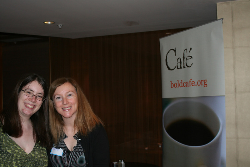 Heather (left) and Beth pose near the fabulous Cafe banner. Cafe, an online magazine for young adult women, is promoted at this event.