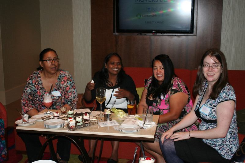 Vanessa (from the left), Sunitha, Jen and Heather stop by after work for light refreshments and good conversation.