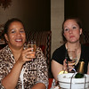 Andrea (left) is enjoying some bubbly while Dana sips some wine refreshment.