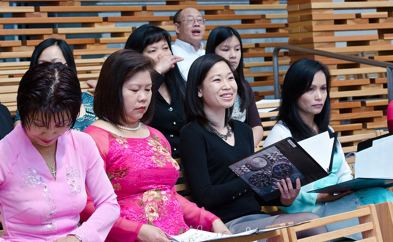 The lady with the brightest smile is Thu, Truong's (choir director) wife.