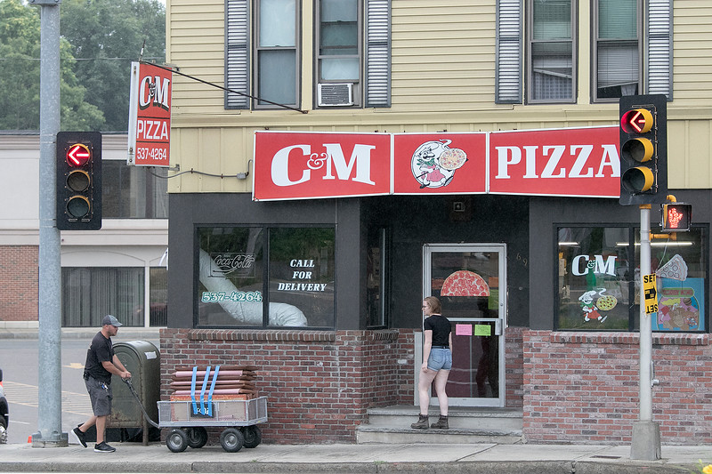 Actor Chris Evans was in Leominster on Thursday, July 18, 2019 filming for his mini series Defending Jacob. They used the parking lot of Leominster Market and C&M Pizza for the shoot. You can see the crew taking in some new seats into C&M for the shot early on Thursday morning. SENTINEL & ENTERPRISE/JOHN LOVE