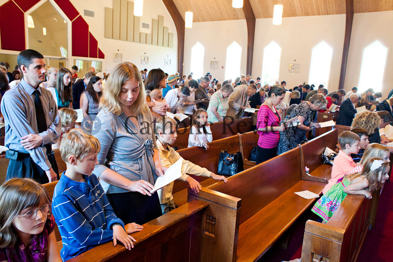 Parishioners at Christ the King Church, Towson recite the Nicene Creed during a Solemn Mass for Confirmation and Reception into the Roman Catholic Church June 24. TOM McCARTHY JR. | CR STAFF