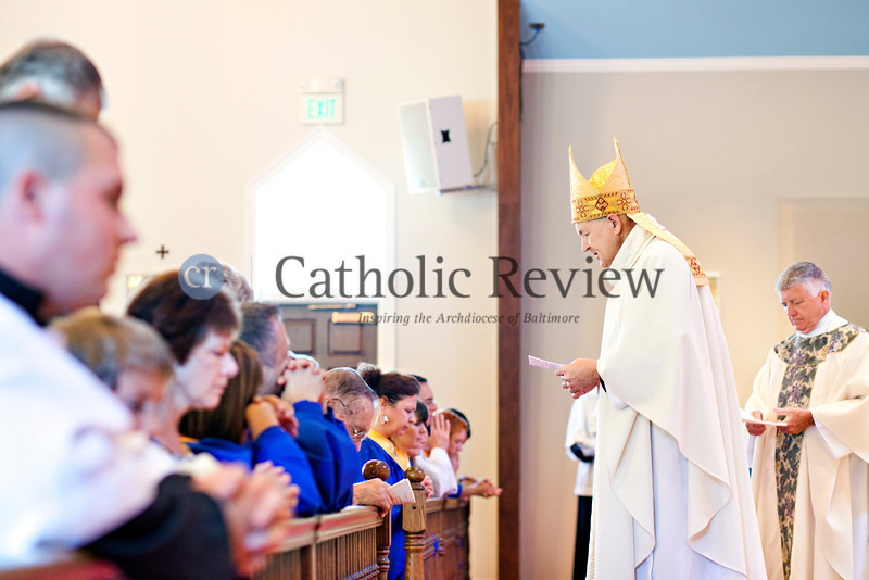 Monsignor Jeffrey N. Steenson, ordinary for the Personal Ordinariate of the Chair of Saint Peter, with Father Edwards Meeks celebrate a Solemn Mass for Confirmation and Reception into the Roman Catholic Church at Christ the King Church, Towson June 24. TOM McCARTHY JR. | CR STAFF