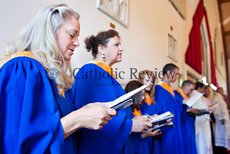 The choir sings the closing hymn during a Solemn Mass for Confirmation and Reception into the Roman Catholic Church at Christ the King Church, Towson June 24. TOM McCARTHY JR. | CR STAFF