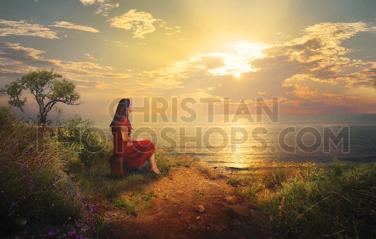 Woman enjoys sunrise