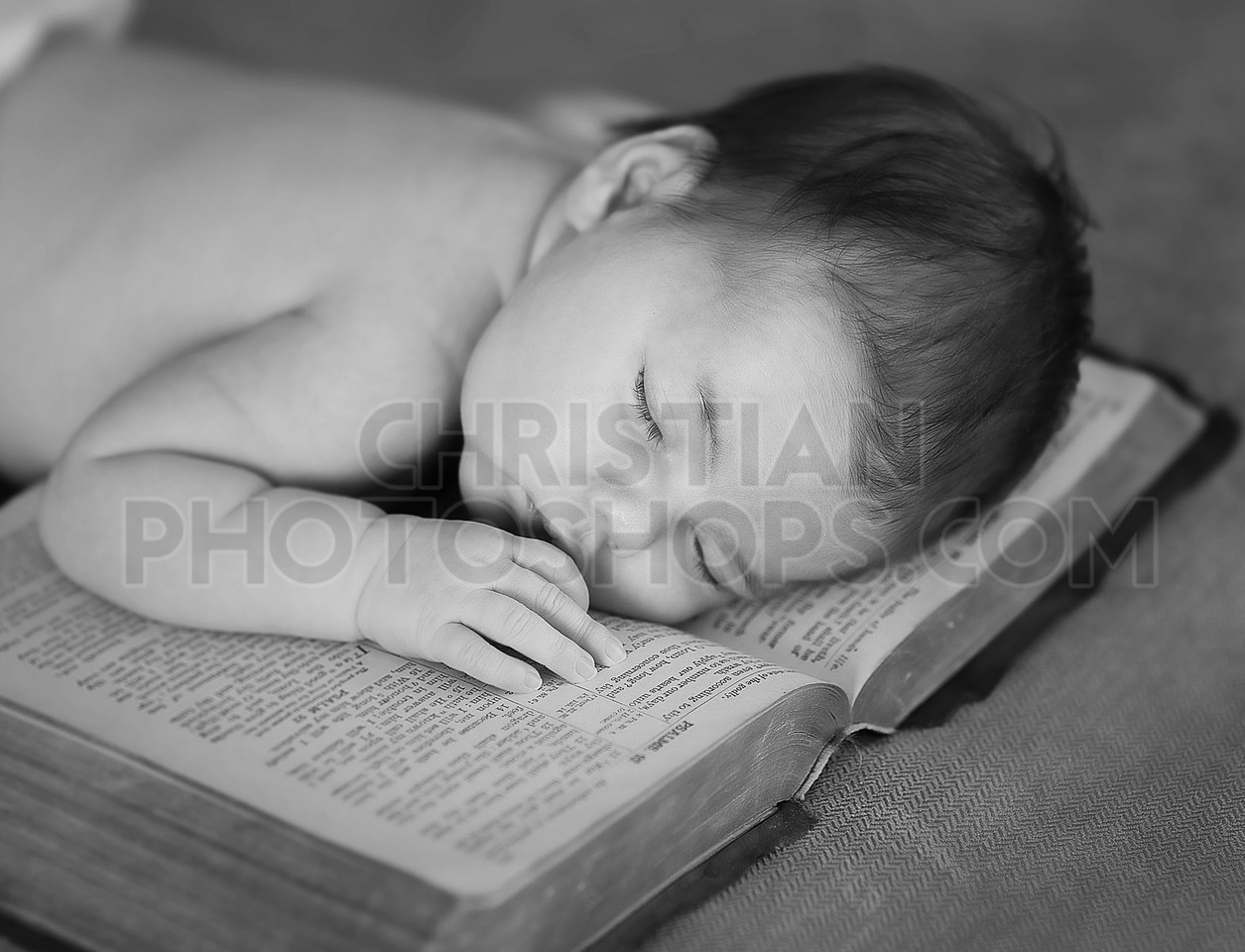 Newborn sleeping on Bible