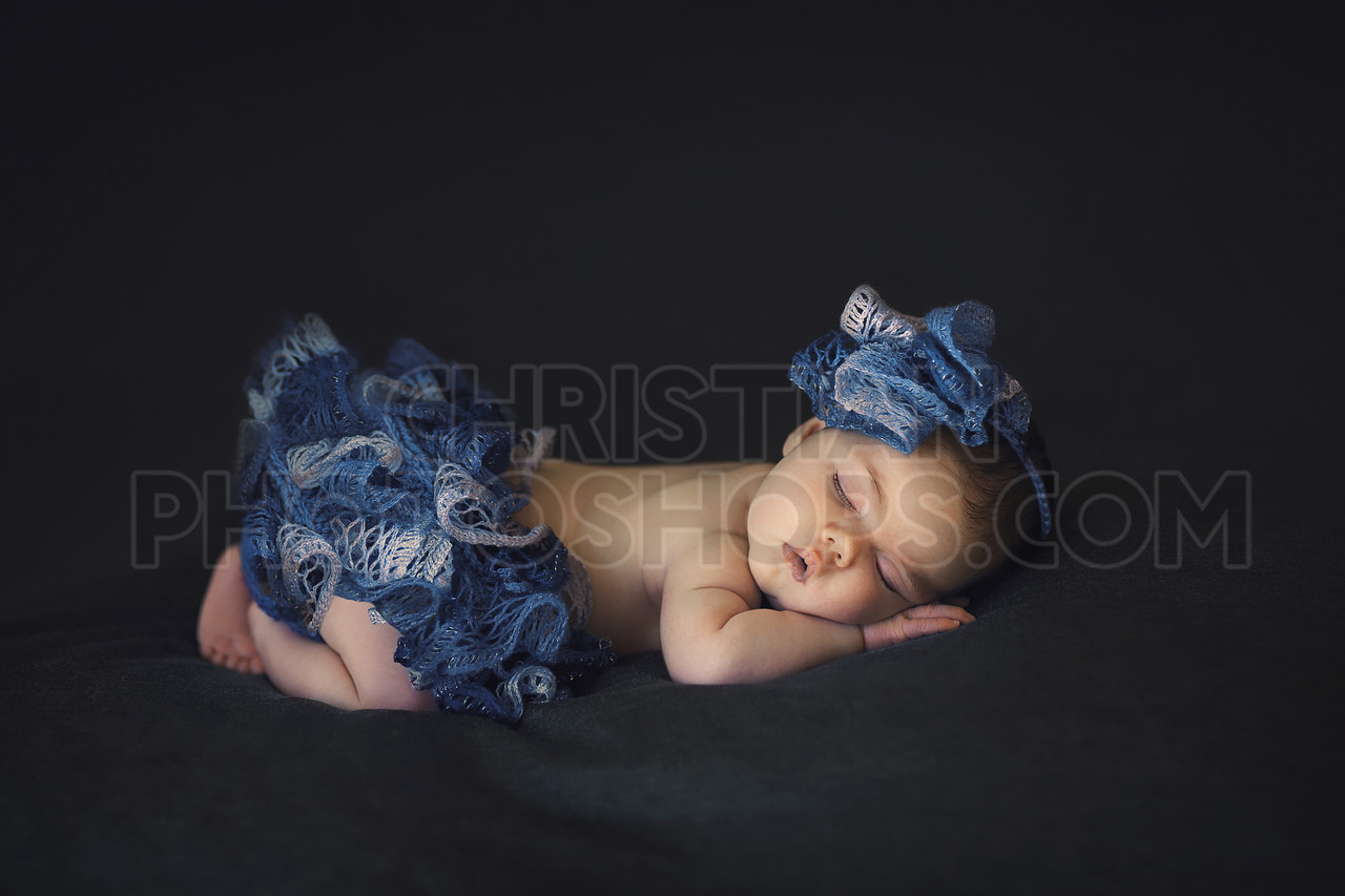 Newborn and blue outfit