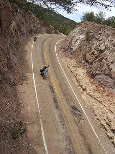 Mike rounding a curve in Mexico (Mike is on the motorcycle)