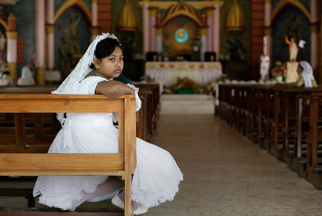 . An Indian Christian girl waits for a ceremony at a Church on Easter Sunday in Gauhati, India, Sunday, April 16, 2017. Christians make up about 2.3 percent of India\'s population of 1.26 billion. (AP Photo/Anupam Nath)