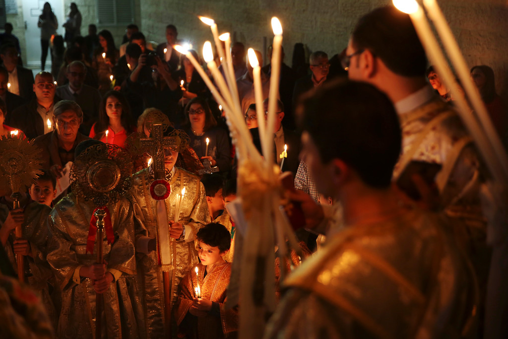 . Orthodox Christian worshippers hold light candles during the Easter Eve service at the St. Porphyrios church in Gaza City, Saturday, April 15, 2017. Christians have gathered at the church for the fire ceremony that celebrates Jesus\' resurrection. (AP Photo/Adel Hana)