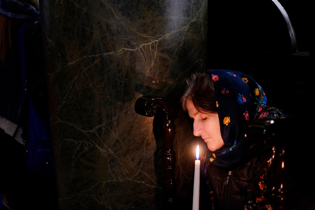. An Orthodox worshipper holds a candle during the Easter Resurrection Service at the Patriarchal Cathedral of St. George in Istanbul, early Sunday, April 16, 2017. Ecumenical Patriarch Bartholomew I, the spiritual leader of the world\'s Orthodox Christians, led hundreds of worshippers at a midnight liturgy to celebrate Easter. (AP Photo/Lefteris Pitarakis)